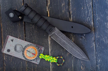 A large knife with a fixed blade with compass. Military bayonet-knife. Top view.