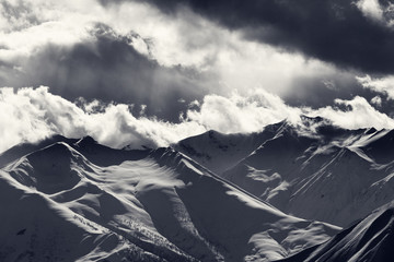 Fototapete - Evening mountains and cloudy sky with sunrays