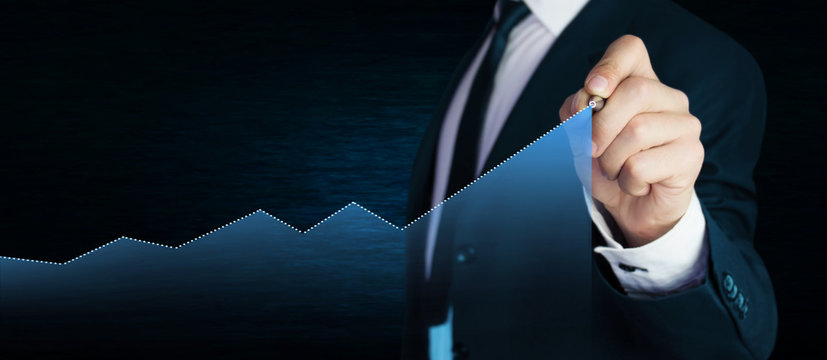 Man with business graph. Business concept.