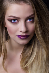 Bright make-up on for a beautiful photo models.