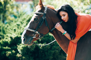 fashionable brunette with a racehorse