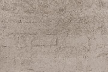 Plastered brick wall, large bricks, color toning, surface