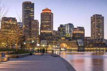 The Boston Harbor anf Financial District in Boston, Massachusetts, USA at night.