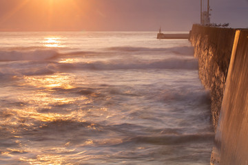 Sunrise on the empty pier in Seahouses,  Great Britain