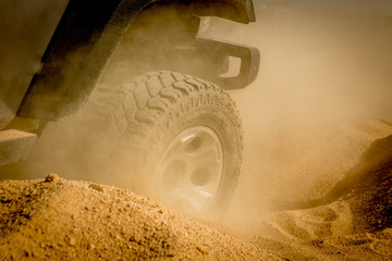 Offroad  rally track and Tyre splashing sand Wall mural