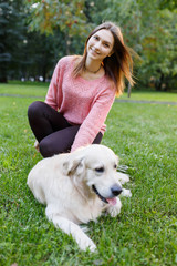 Photo of girl and retriever lying on lawn