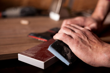 close up of carpenter hands working on wood