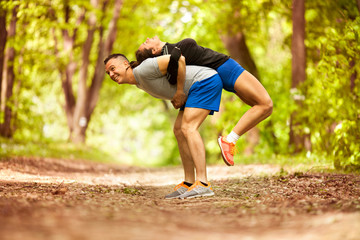 Fitness couple stretching outdoors in park