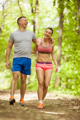 young happy fitness couple in forest