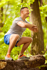 Portrait of  sporty young man  outdoors in nature