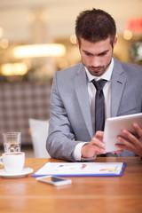 businessman in the coffee break working on his ipad