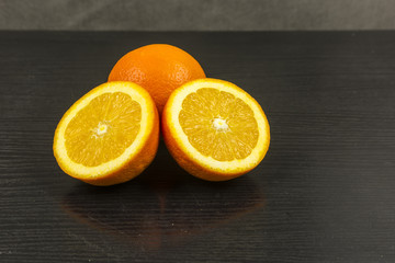 Sweet orange cut on a wooden table.