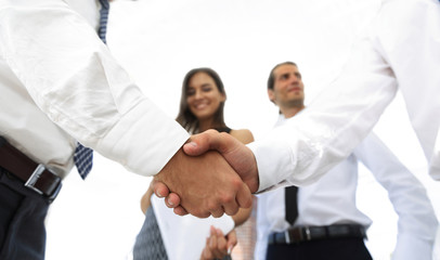 background image of handshake of business partners.