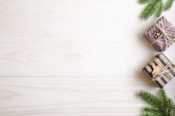 Christmas still life with gifts on a white wooden background with a Christmas tree. New Year gifts