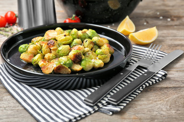 Plate with roasted brussel sprouts on table