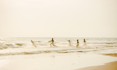Children playing on the beach in Gabon