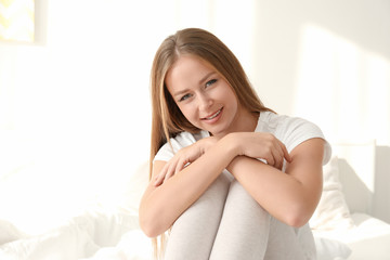 Beautiful young smiling woman at home