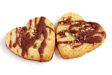 isolated couple of heart shape cookies with chocolate and nuts with copy space, simbol of love