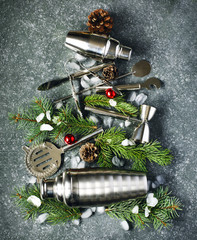 Fir tree made from Set of bar tools and ingredients for making a cocktails arranged on a stone background. Christmas concept