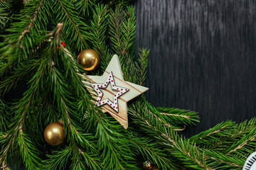 Christmas toys. Christmas background. Black background. Real tree