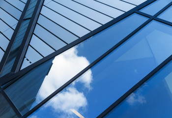 Reflections of sky and clouds in modern building