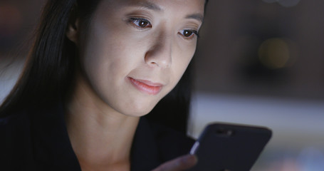 Businesswoman use of cellphone at night