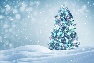 Decorated Christmas tree outdoors falling snow background