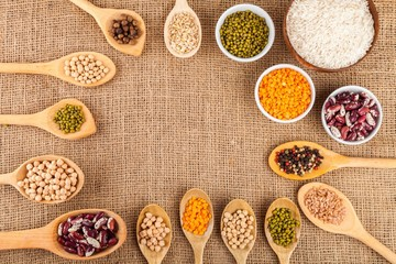 Assorted grain, beans, legumes, peas, lentils in spoons on a