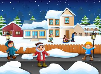 Happy kid plaiyng in the snowing village