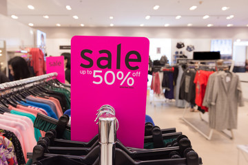 sale up to 50% off mock up advertise display frame setting over the clothes line in the shopping department store for shopping, business fashion and advertisement concept