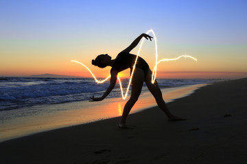 Skilled Young Dancer at the Beach During Sunset