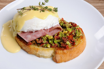 Toast with guacamole with egg Benedict