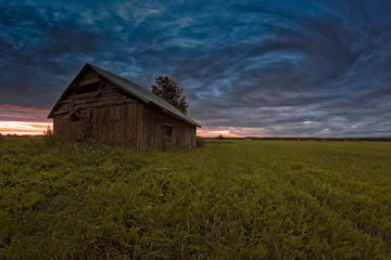 Old Barn House Under The Dramatic Summer Skies