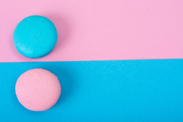 Small French macaroons on pastel background