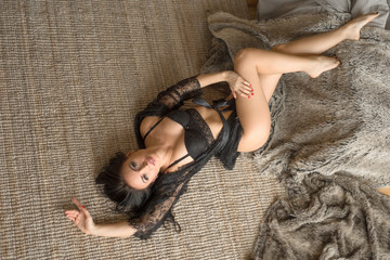 sexy beautiful girl in black lace lingerie lying on the floor