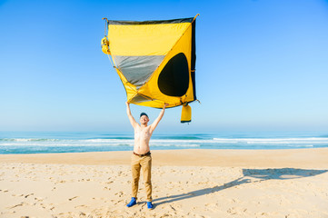 Odd bizarre happy smiling topless man holding tent above head. Young guy have fun on beach. Sunny morning on atlantic ocean in Portugal.  sc 1 st  Fotolia & Search photos