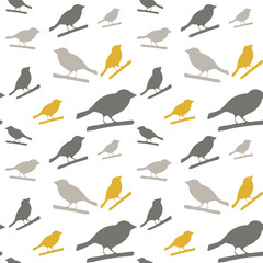 Birds pattern. Vector seamless pattern with hand drawn silhouettes of birds on a tree branch.