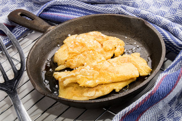 scrambled egg in an old cast iron pan