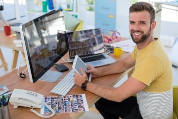 Male executive looking at photos at desk