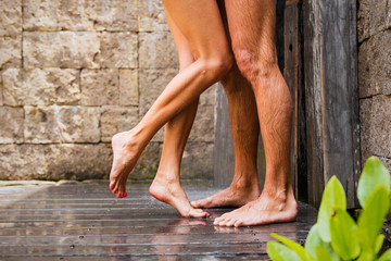 Couple standing in shower together