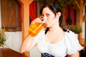 Young German Woman Enjoying A Mug Of Beer