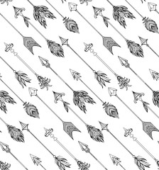 Seamless texture with boho arrows with different tips and plumage. Vector doodle pattern for your creativity