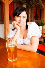 Young German Woman Enjoying A Mug Of Beer