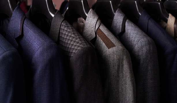 Mens suits on hangers in different colors