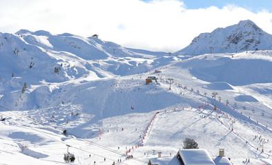 Alpine ski slope in sunny weather