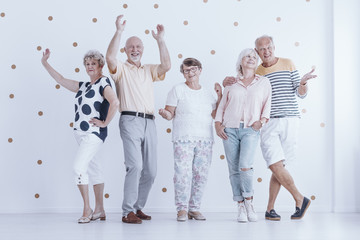 Senior people dancing each other