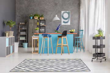 Room with painted blue table
