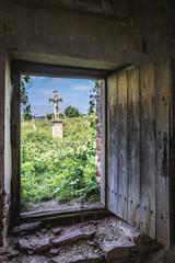 Ntrance to old burial chapel on abandoned Catholic cemetery near Chervonohorod Castle ruins in Ukraine