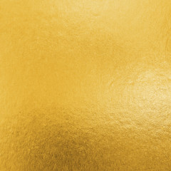 Gold foil leaf metallic wrapping paper shiny texture background for Christmas and holiday wall paper decoration element