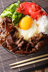 Japanese Beef Rice Bowl, Gyudon close-up on the table. Vertical top view